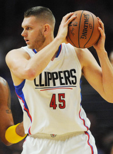 March 13, 2016; Los Angeles, CA, USA; Los Angeles Clippers center Cole Aldrich (45) moves the ball against Cleveland Cavaliers forward Channing Frye (9) during the first half at Staples Center. Mandatory Credit: Gary A. Vasquez-USA TODAY Sports